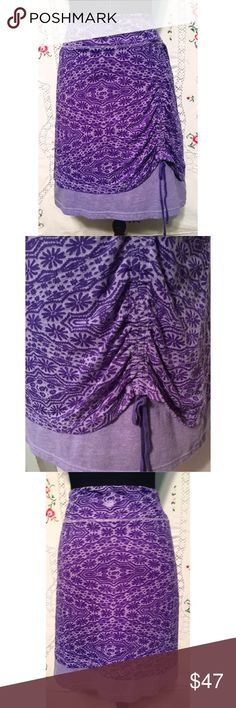 "Athleta Stretchy 2 Layer Skirt Ruched Front XL Summer skirt made by Athleta. Top layer is a stretchy purple print and is ruched over a second solid layer. Small hidden pocket for a key inside. Size XL. Cotton poly blend. Good condition. Length is  20."" and waist measures 18"". Very good used condition. Athleta Skirts"