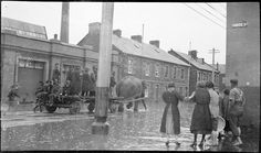 Hobart - Hunter Street - flooded street scene (shows elephant pulling a cart!)   by Tasmanian Archive and Heritage Office Commons