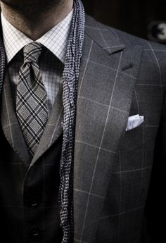 Tricky mixing of same patterns in three sizes. But pulled out really well. http://www.moderngentlemanmagazine.com/mens-style-suits-pattern-mixin/