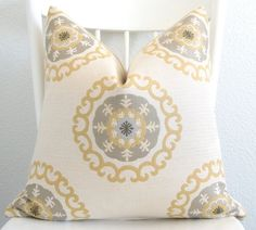 @kim, do you have this pillow already?  i love it for your yellow and grey decor.