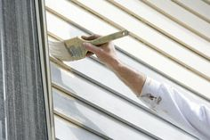 How Prep and Paint Vinyl Siding Painting vinyl siding is much like painting other types of siding but comes with a few special rules and things to check. Learn how to do it right. Painting Vinyl Siding, Vinyl Siding Colors, Mobile Home Exteriors, Vinyl Siding Repair, House Siding, Exterior Siding, Exterior Paint, Exterior Makeover, Houses