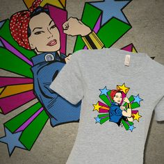 EVERYDAY HERO TEE - Shirt features a re-imagined illustration of the American icon, Rosie the Riveter. Designed to empower, inspire and celebrate. Available in selected colors. #rosie-the-riveter, #tshirt, #tshirts, #tees, #teeshirt, #asian #hero, #heroine, #heroines, #girlpower #we-can-do-it, #ethnic