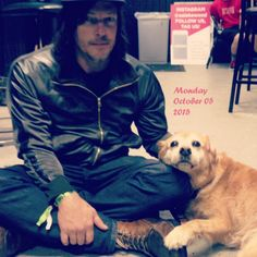 That little dog looks so thrilled to be resting on Norman's leg. Same, little dog. Same. Haha