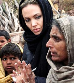 November 26, 2005    Jolie spent Thanksgiving listening to an earthquake survivor during her visit to Jabel Sharoon, a remote village in Pakistan-administered Kashmir.