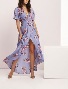 Slender straps cinch the waist of this party-ready wrap maxi dress cut with a plunging neckline and split-front skirt.