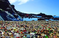 The Glass Beach in Fort Bragg CA is also called Mermaids Tears, Lucky Glass, Ocean Glass and Sea Gems. Today, it is filled with rounded bits of sea glass. They glisten in the sun like little marbles. Fort Bragg CA has become a popular tourist destination in California because of this beautiful and unique Glass Beach.