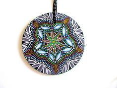 Kaleidoscope Bursting Flower Hand painted Glass Ornament. $39.60, via Etsy.