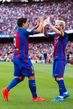 Luis Suarez (L) of FC Barcelona celebrates with his teammate Lionel Messi after scoring his team's fourth goal during the La Liga match between FC Barcelona and Real Betis Balompie at Camp Nou on August 20, 2016 in Barcelona, Catalonia.
