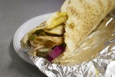 Chicken Shawarma with it's juicy shreds of spit-roasted chicken are as good as you could hope for, but it's the lemon-garlic sauce, pungent enough to stay on your breath for hours, that makes this sandwich a real knockout.