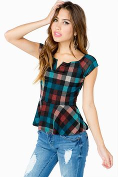 So perfect for fall, this peplum top combines the flirty, off-the-shoulder girliness of a peplum top with the rugged factor of autumnal plaid. Split neck. Cap sleeve. Flared skirt.