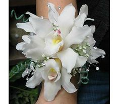 Wrist Corsage with white Orchids and a little bling.