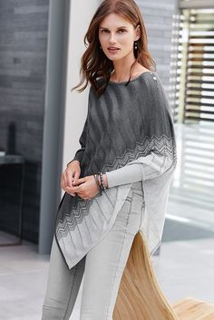 Prepare to be intrigued by this sweater poncho, featuring a zigzag pattern and shadow stripes, revealing a hint of skin. Winter | White House Black Market