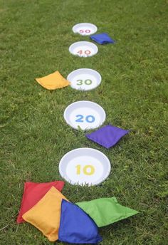 How to make a unique DIY bean bag toss game from terra cotta pot saucers and a printable (which you can get for free by clicking through!). Kids will love it! Such a fun homemade idea for spring or summer.