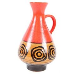 Bring one-of-a-kind style to your home d�cor with this vintage clay vase, beautifully crafted in mid-century West Germany.  Product: VaseConstruction Material: StonewareColor: Brown and orangeFeatures: West German design, circa 1950sDimensions: 9 H x 5 DiameterNote: Due to the vintage nature of this product, some wear and tear is to be expected. Products may show signs of brand marks, scrapes or other blemishes.Cleaning and Care: Wipe with a damp cloth