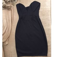 Black plunge dress Black plunge dress . Perfect for any occasion. Zipper in back. Gently worn, great condition. ANGL Dresses Strapless