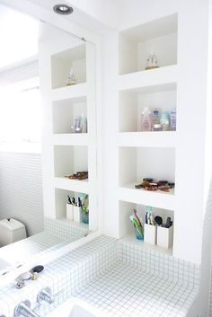 Remember to add in built in shelving when remodeling a bath