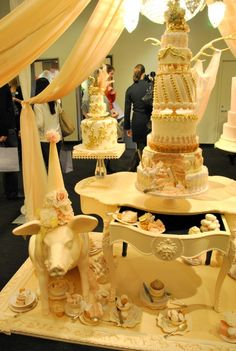 Party pig display in mandap-style tent by Cake Opera Co. at at The Wedding Co. Show 2012.