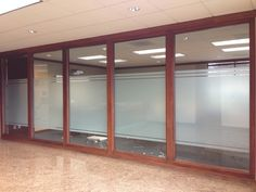 Decorative Frost window film installed for privacy in conference room - window tinting for commercial buildings and office spaces. WindowTintLA.com