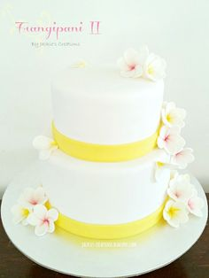 Frangipani Wedding Cake - I made this cake for my friends who had their NZ wedding reception this past weekend.  They got married in Rarotonga a couple of weeks before that and wanted to represent that in their cake, hence the frangipanis :-)  I hope you enjoy browsing through the photos.  Stay blessed!  TFL xo