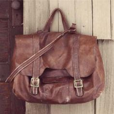 i always wanted a worn leather bag just like this.