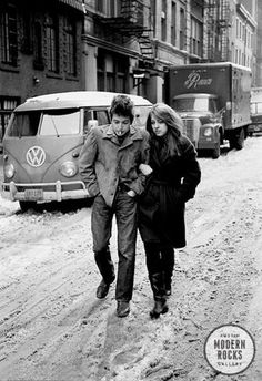 "Bob Dylan Freewheelin cover outtake"" by Don Hunstein.  Location: West 4th St NYC Date: Feb 1963 An alternate take from 'The 'Freewheelin' Bob Dylan' album cover shoot, featuring Bob with Suze Rotolo photographed on West 4th Street in New York City in February 1963."