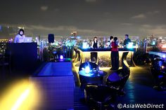 Blue Sky is a stylish and intimate rooftop bar and restaurant in the northern part of Bangkok, on top of the Centara Grand Lad Prao Hotel. Due to its location on the 24th floor, Blue Sky offers uninterrupted views of downtown Bangkok in one panoramic shot, with endlessly
