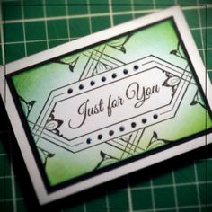 An Artist Trading Card made with the Inkadinkado Stamping Gear and stamps.