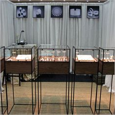 Independent jewelry cases have convenient storage underneath display area.