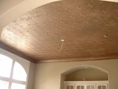 this is a faux copper ceiling where anaglypta was hung on the ceiling and painted with copper metalic paint.  Anaglypta is a wonderful product with so many applications, I'm suprised we don't more of it.