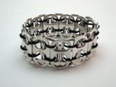 Soda can tabs are made into a bracelet: good for Wasteland Weekend/ Post-Apocalptic costuming