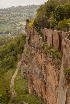 Orvieto, Terni - Umbria. Dating back to Etrsuscan time Orvieto is situated on a flat summit of a volcanic cliff completed by defensive walls of the same stone. Amazing!