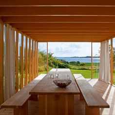 Indoors/outdoors dining table  The house is located in Göteborg and designed by Gert Wingardh