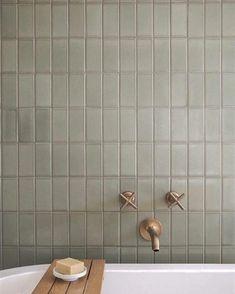 modern bathroom design iwth modern tile, modern stacked gray tile with gold bathtub faucet, tile over bathtub in neutral bathroom design, Simple Bathroom Designs, Modern Bathroom Design, Modern Bathrooms, Baths Interior, Bathroom Interior, Laundry In Bathroom, Small Bathroom, Master Bathroom, Neutral Bathroom Tile