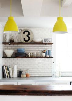 white tiles, shelves and yellow lamp shades Kitchen Interior, New Kitchen, Kitchen Decor, Kitchen Yellow, Kitchen Tiles, Kitchen Styling, Kitchen Pendants, Kitchen Lamps, Neutral Kitchen