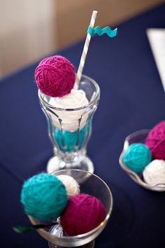 """Vintage Sweet Shoppe Baby Shower YARN BALL ICE CREAM BOWLS & ICE CREAM SODA   out of styrofoam balls and different colors of yarn. For the """"bowls of ice cream"""", display 3 different sizes of in scoops in decorative dessert dishes.      Add a stripey straw to the """"soda"""" and embellish it will a piece of ric rack ribbon to form a straw flag. The ric rack ribbon also helps play up the baby shower element."""