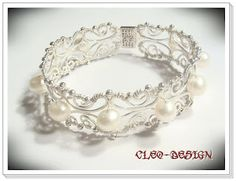 Cleo-Design pearl and wire bracelet.  This site is in Hungarian, but it's easy to Google translate it.  The pictures are enough to inspire on their own anyway.  wow