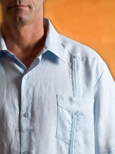 """http://theguayaberashirtstore.com Long Sleeve - Classic Linen Guayabera  View Full-Size Image    This J. Edwards """"Guayabera"""" shirt is made from 100% Chinese linen. This design is patterned after the traditional """"Classic"""" Guayabera as worn in Mexico and Latin America. It features a simple pleated panel on the front and the back of the shirt, four front pockets, and a yoke across the back and along the bottom hem. It's a beautiful and elegant shirt that you can wear on any occasion"""
