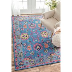 This handmade wool area rug uses subtle and modern colors to match today's interiors. Plush wool pile offers great comfort under foot.