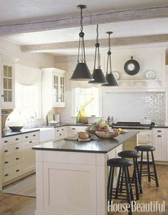 Black countertops on white cabinets with a subway tile splash.