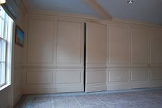 Wainscoting Raised Panel Walls With Hidden Door