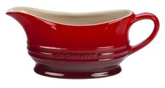 Le Creuset Stoneware 12-Ounce Gravy Boat, Cherry by Le Creuset of America. $24.95. A perfectly color-matched palette of bold, consistent tones for easy mixing and matching with other le creuset products. High-quality exterior enamel protects against metal marks and other damage. Hard-wearing, impermeable finish fired at temperatures as high as 2192-degree F. Unmatched thermal resistance from -65ºf to 500ºf  safe for the freezer, microwave, oven, broiler and dishwasher. L...