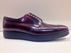 Burgundy patent leather Prada wind tip with stacked sole.