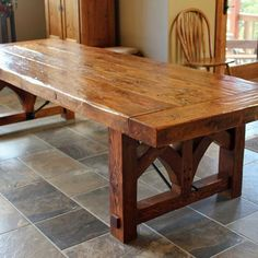 farm-style dining table, hand-made from reclaimed barn wood. on