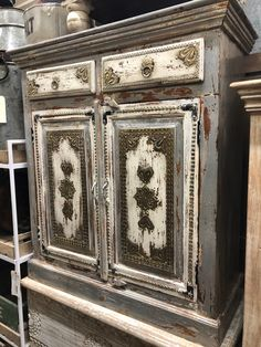 This beautiful decorated, hand painted, handcrafted, solid wood cabinet is made in India and is authentic.  We love our beautiful painted & embellished pieces!  Manzel, 96 Foster St., Peabody, MA and www.manzelinc.com Rustic Wood Furniture, Solid Wood Cabinets, Online Furniture Stores, Paint Colors, Carving, Hand Painted, India, Boho, Painting