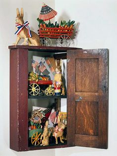 Simple Patriotic Presentation-A rustic wood medicine cabinet repurposed to show off your patriotic collection (and spirit).