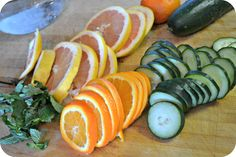 Dr. Oz Fat Flush Drink Helps to lose weight. Slice 1 Tangerine, 1 Grapefruit, 1 Cucumber add 12 Peppermint leaves and  1800ml of water, steep overnight in a pitcher.