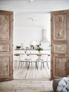 Scandinavian flat, housed in a 1907 residence building in Gothenburg. The bright renovated space is flooded with natural light, and abraded-wood elements tie back 20th century charm while contrasting the interior's bright neutral tones with rustic accents.
