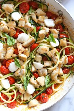 Sauteed bite-sized chicken breast and grape tomatoes cooked with spiralized zucchini, fresh mozzarella and basil – an easy 15-minute meal! When making zoodles (zucchini noodles) I prefer a thicker noo