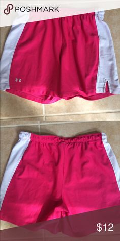 Under Armour Pink white Basketball Shorts Size medium athletic shorts. These are in great condition with no holes or stains. There is some sharpie writing on the tag only. These have an elastic waistband with a drawstring. Under Armour Shorts
