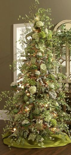 Laurel Bern Interiors List of 22 Magical Christmas Trees | absolutely exquisite and unique decorations on this elegant Christmas tree